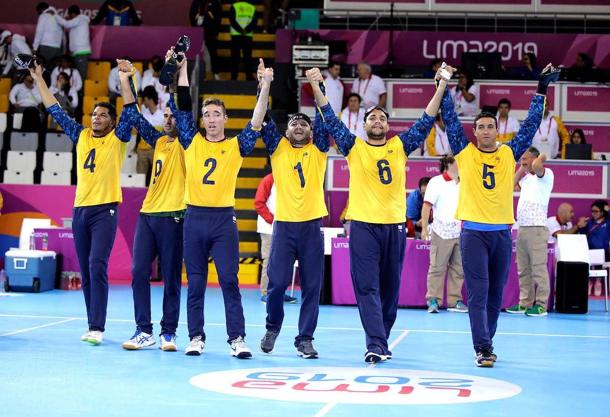 Brazilian men's goalball team celebrate by joining hands at Lima 2019